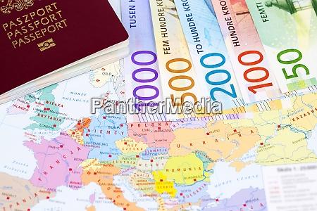 norwegian money with passport on the