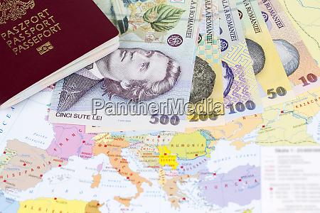 passport with romanian money on the