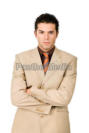 junge geschaeftsmann portraet in weissem hintergrund