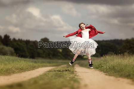 portrait of happy girl wearing red