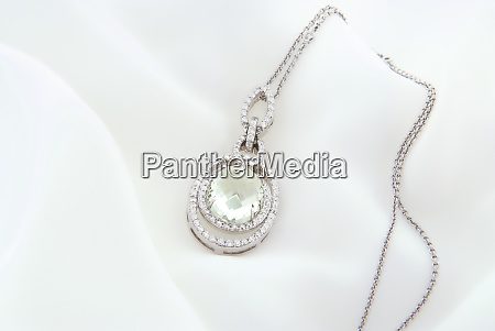 white gold pendant with green amethyst
