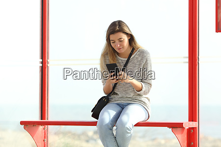 girl checking mobile phone information in
