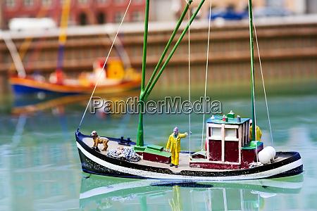 rettungsboot retter und hund miniatur szene