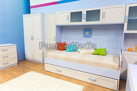 bright bedroom with a bed and