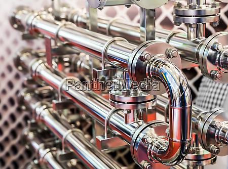 steel water pipeline metal fittings closeup