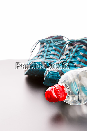 sports runners and a bottle of