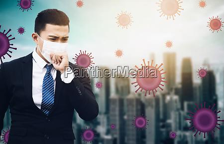 gestresster geschaeftsmann traegt schutzmaske gegen grippevirus