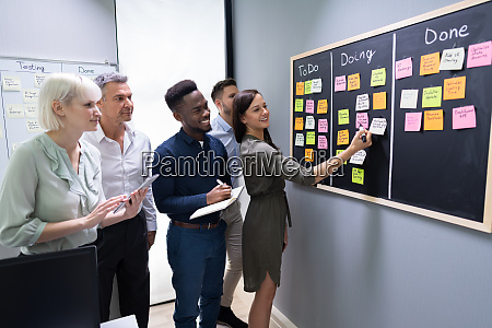 group of people writing on sticky