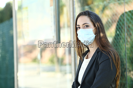 woman wearing a mask to prevent