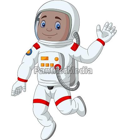 cartoon junge astronaut winkende hand