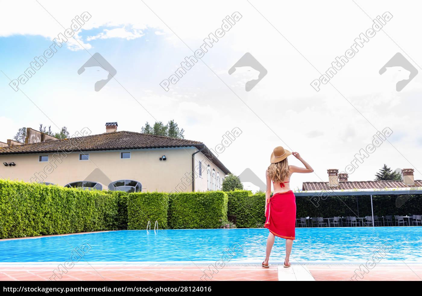 woman, in, red, bikini, by, swimming - 28124016