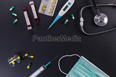 blood test tube with the coronavirus