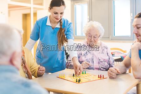 seniors and nurses in nursing home