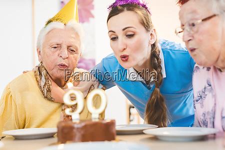 senior men and women celebrating birthday