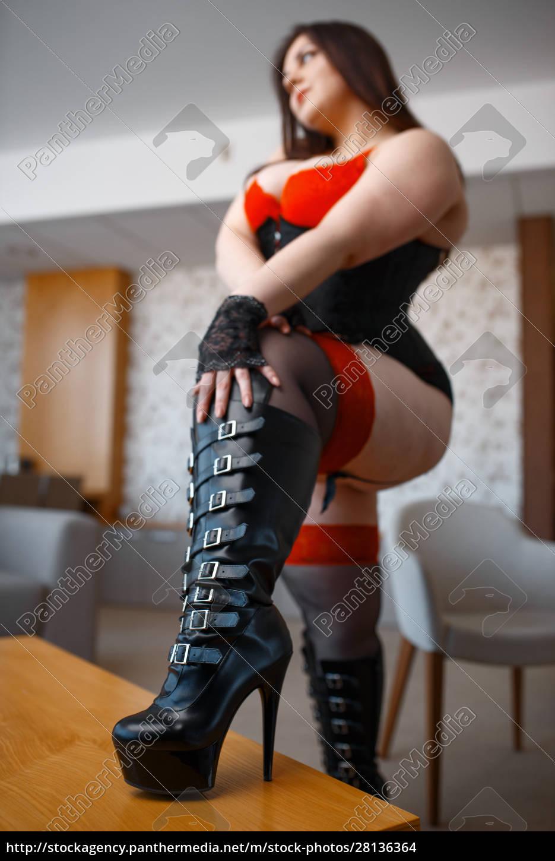 fat, debauchery, woman, in, black, leather - 28136364