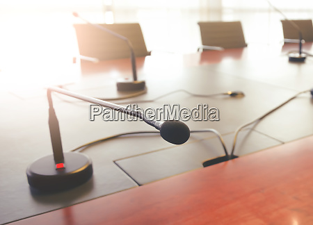 tabletop microphone on a wooden table