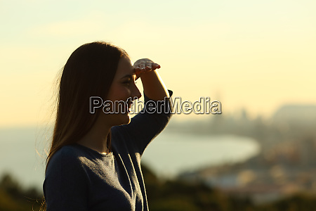woman silhouette protecting from sun with