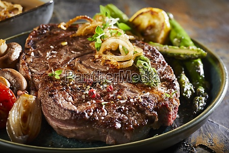 succulent grilled beef steak with asparagus