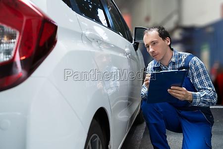 insurance agent inspection car paint