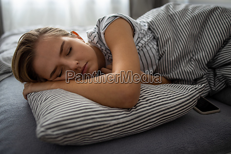 pretty young woman sleeping in her