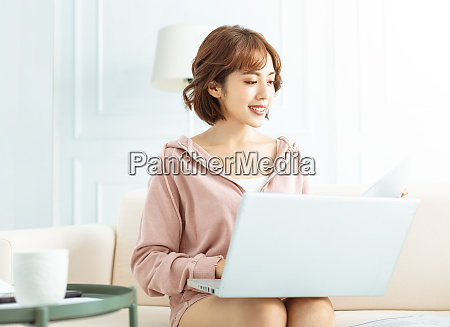 happy casual beautiful woman working on