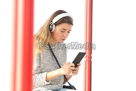 teenage girl listening to music using