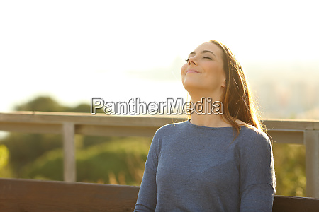 woman sitting on a bench breathing