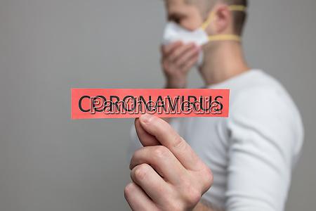 mann, mit, atemmaske, das, coronavirus, covid-19, zeichen - 28176939