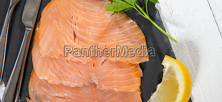 delicious raw salmon fish fillets on
