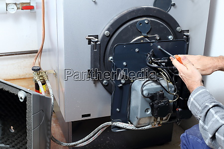 worker is mounting a heating burner