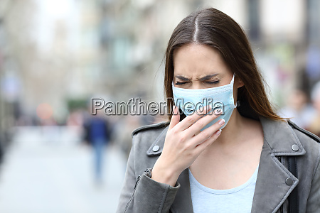 sick woman with protective mask coughing