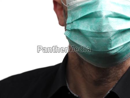 geschaeftsmann mit medizinischem mundschutz