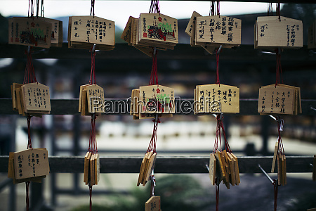 close up of wooden tablets with