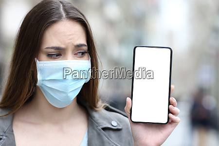 scared girl with mask looking at