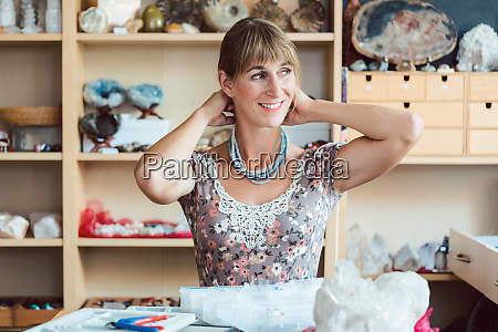 woman trying a necklace hand made