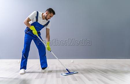 worker mopping floor