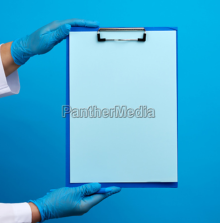 female doctors hands in blue medical