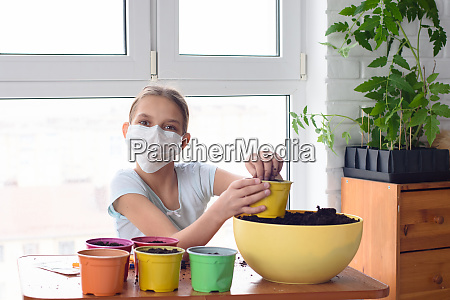 a quarantined girl pours earth into