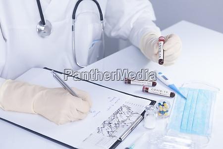 doctor hands holding covid 19 coronavirus