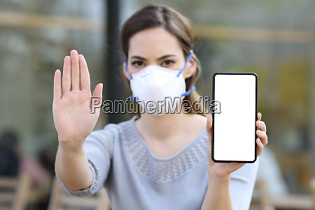 girl with mask gesturing stop showing
