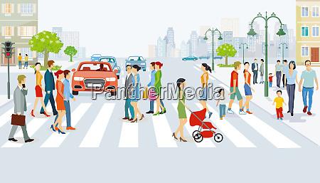 strassenverkehr mit fussgaengern auf dem fussgaengerueberweg