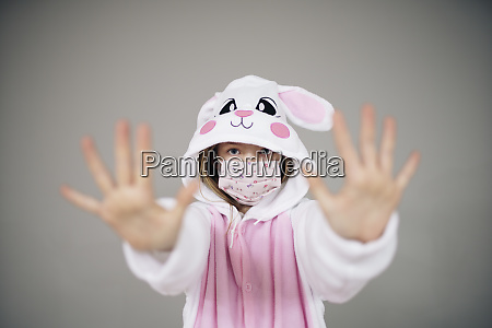 beautiful girl dressed as easter bunny