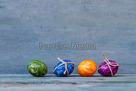 four colourful easter eggs on a