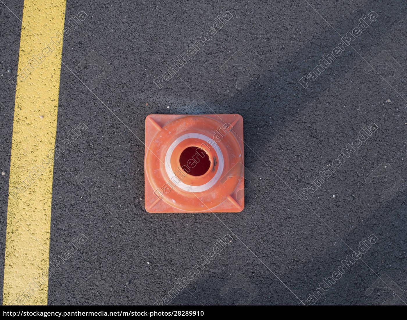 traffic, cone, with, shadow, on, asphalt - 28289910