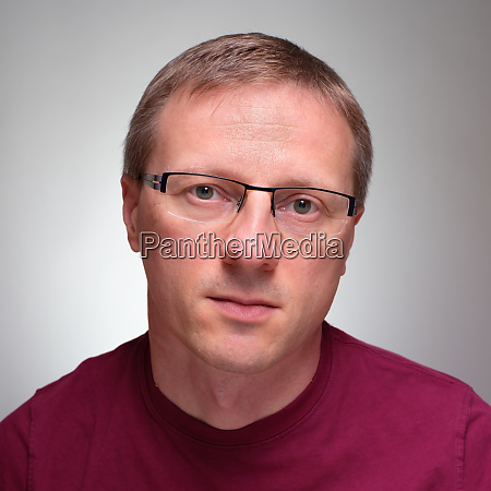 frontal portrait man with glasses
