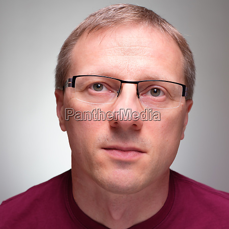 man with glasses is looking up
