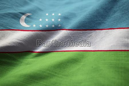 nahaufnahme von ruffled usbekistan flagge usbekistan
