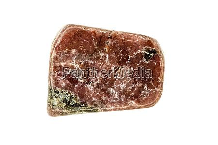 rhodonit edelstein auf weissem hintergrund ausgeschnitten