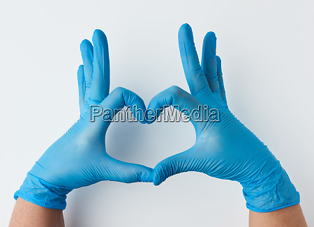 two hands in blue latex sterile