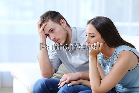 sad worried couple complaining on a